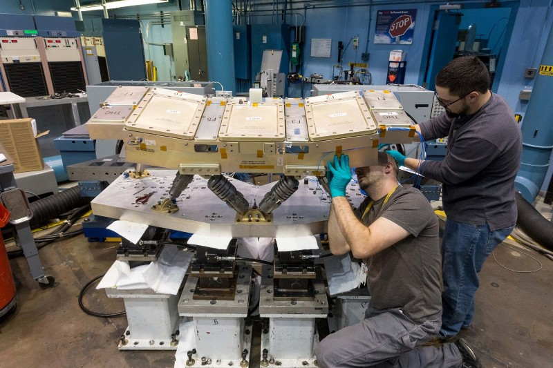 The Orion spacecraft Crew Console undergoing vibration testing on two T2000 shakers mounted horizontally at the Acoustic Vibration Lab at Lockheed Martin's Space Systems Company headquarters in Littleton, CO