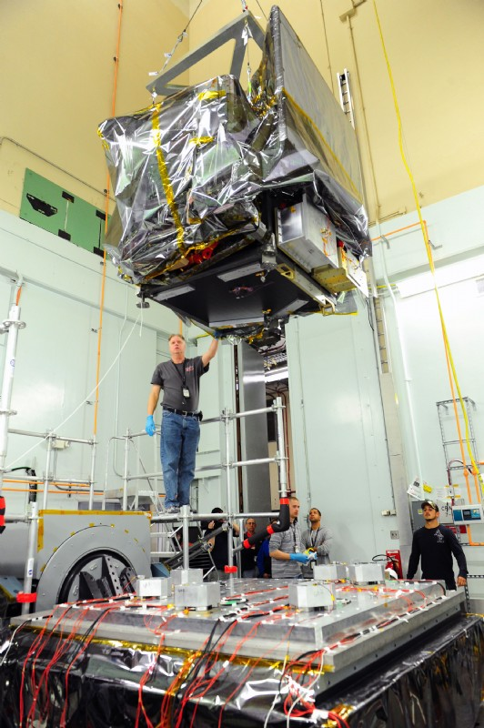ICESat-2 satellite being lowered onto an Unholtz-Dickie shaker for vibration testing at NASA Goddard