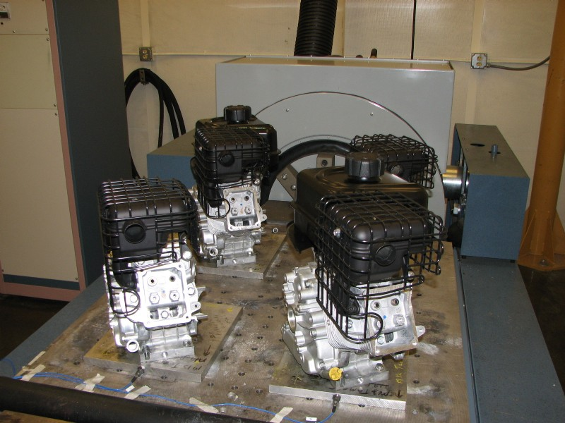 Four small engines are simultaneously tested on a horizontal slip table